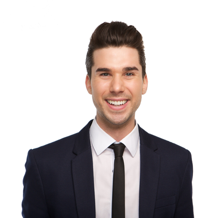 Close up portrait of a smiling young business man on isolated white background photo