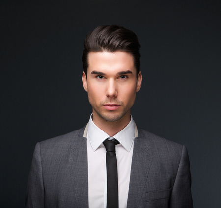 Close up portrait of a handsome male fashion model in business suit photo