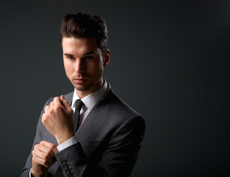 Close up portrait of a trendy young man in modern business suit Stock Photo