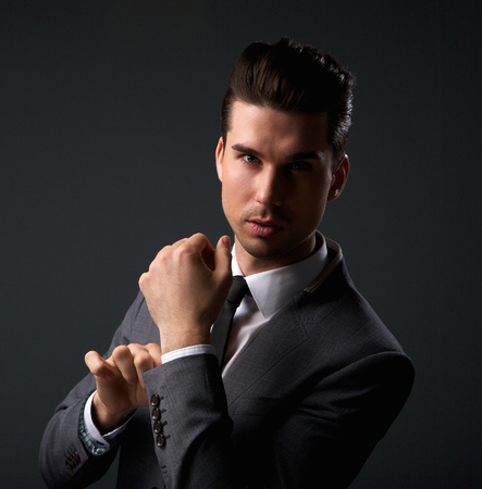 Close up portrait of a cool young guy in modern business suit photo