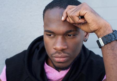 black man thinking: Close up portrait of a handsome black man thinking Stock Photo