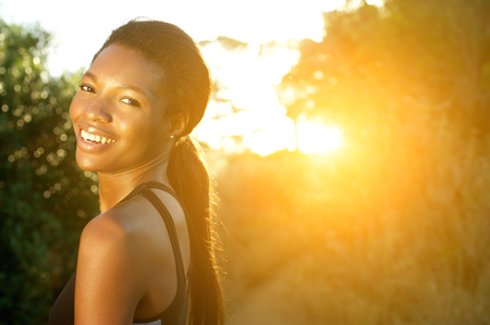 athletic women: Close up portrait of an attractive young sports woman smiling outdoors