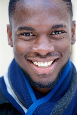 Close up portrait of a happy young black man smiling photo