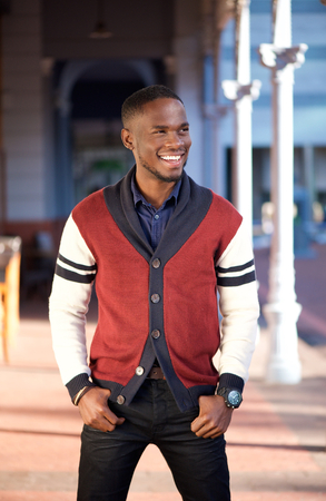 trendy male: Portrait of a charming young african american man smiling outdoors