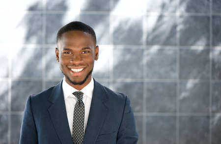 african businessman: Close up portrait of a friendly young businessman smiling Stock Photo
