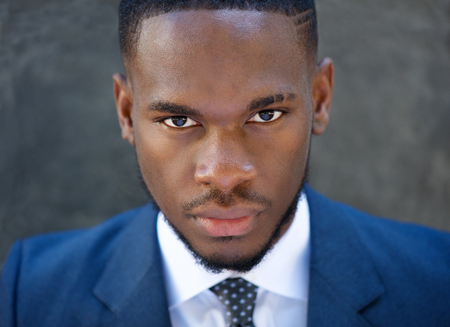 Close up portrait of a handsome young business man in suit photo