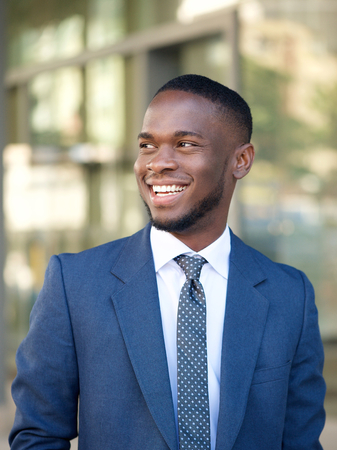 Close up portrait of a confident businessman smiling in the city photo