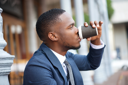 Close up portrait of a businessman relaxing with a cup of coffee during a break photo