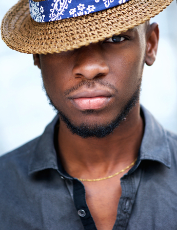 Close up portrait of stylish young african american man with hat photo