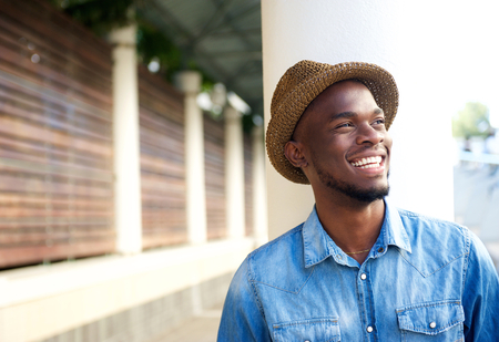 cool attitude: Close up portrait of a cheerful young african american man laughing Stock Photo