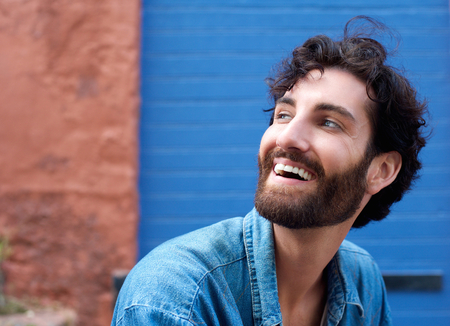 cute man: Close up portrait of an attractive man with beard laughing