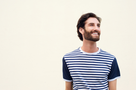 cute man: Portrait of a cheerful young man with beard smiling on white background Stock Photo