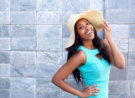 african beauty: Portrait of a happy smiling young woman with sun hat Stock Photo