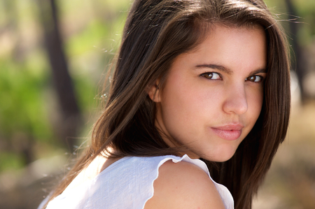 posit: Close up portrait of a sensual young woman with beautiful eyes posit outdoors