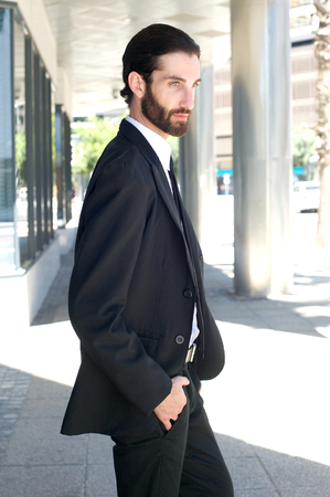 business suit: Portrait of a handsome young businessman walking outside in business suit Stock Photo