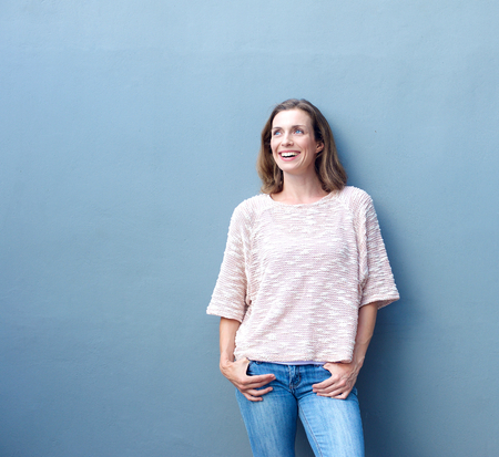 mature people: Portrait of a confident relaxed trendy middle aged woman smiling