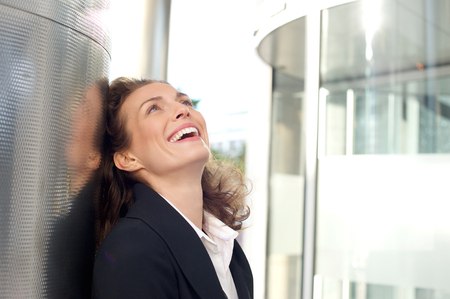 Close up portrait of a business woman smiling outside office building photo