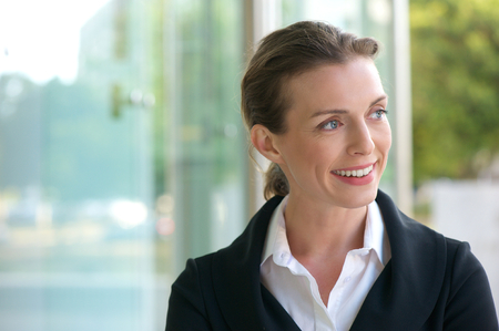 charming business lady: Close up portrait of a career business woman smiling in black jacket and white shirt