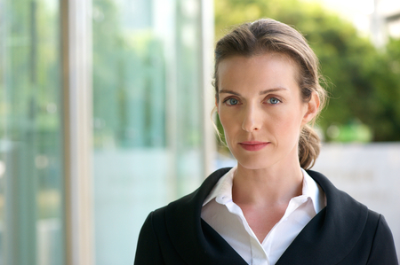 woman white shirt: Close up portrait of an attractive business woman with serious face expression