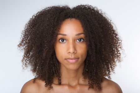 portrait young girl studio: Close up portrait of a beautiful african american young woman with curly hair