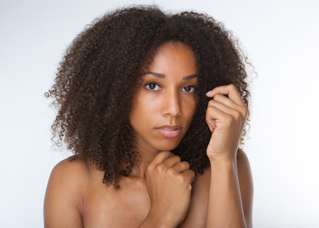 nude girl young: Close up portrait of an attractive african american young woman with curly hair