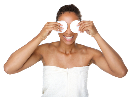 cotton pad: Portrait of a happy woman covering eyes with make up removal pads