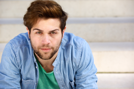 man relax: Close up portrait of a handsome young man with beard looking at camera Stock Photo