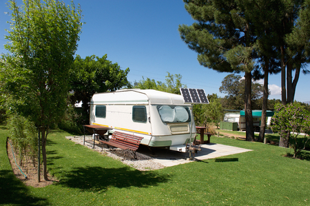camping pitch: Caravan in a relaxing nature camp site Stock Photo