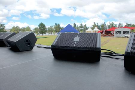 On stage before music festival. Black speaker monitors