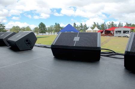 speakers: On stage before music festival. Black speaker monitors