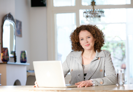 Portrait of a mid adult woman using computer at home