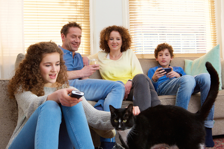 Portrait of a happy family with house pet relaxing at home