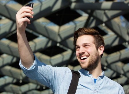 cool guy: Close up portrait of a cool guy taking selfie