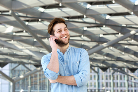cool guy: Portrait of a happy cool guy talking on mobile phone