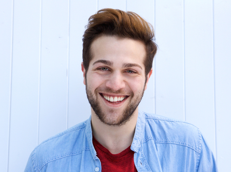 cool guy: Portrait of a cool guy smiling against white  Stock Photo