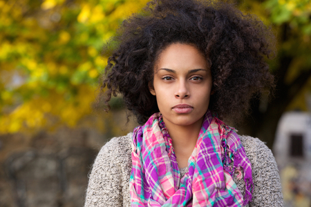 Close up portrait of a beautiful young mixed race girl with afro hair Stock Photo