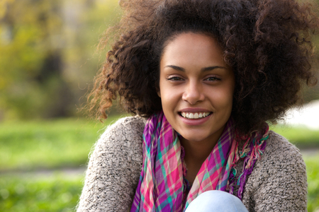 woman relaxing: Close up portrait of a natural african american woman smiling outside