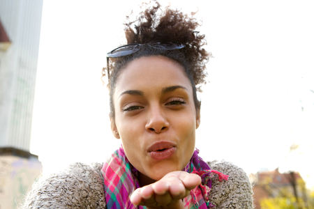love blow: Selfie portrait of an attractive young woman blowing a kiss Stock Photo