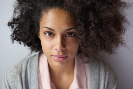 woman serious: Close up portrait of an attractive young african american woman Stock Photo