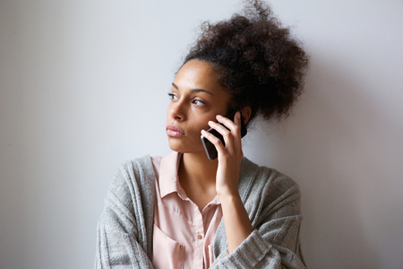 person on phone: Close up portrait of a young woman talking on mobile phone