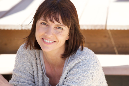 Close up portrait of a healthy older woman smiling outside