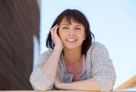 Close up portrait of a fresh natural older woman smiling outdoor
