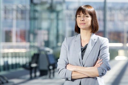 crossed arms: Close up portrait of a professional business woman standing with arms crossed