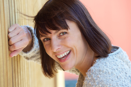 mid adult women: Close up portrait of a friendly middle aged woman laughing Stock Photo