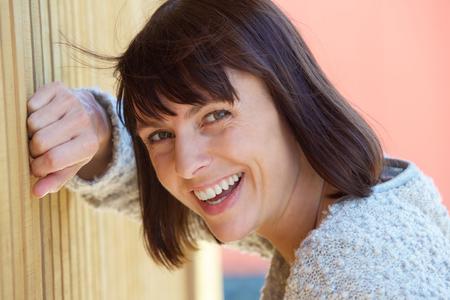 laughing face: Close up Portrait von einer freundlichen Frau mittleren Alters lachend Lizenzfreie Bilder