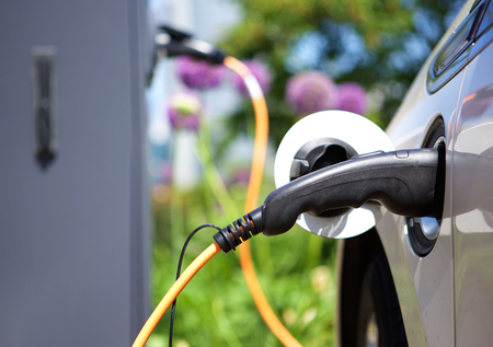 electric energy: Power supply for hybrid electric car charging battery Stock Photo