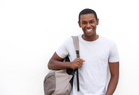 african student: Portrait of a college student smiling with bag on white background