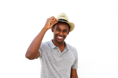 male fashion: Close up portrait of an african american male fashion model smiling with hat