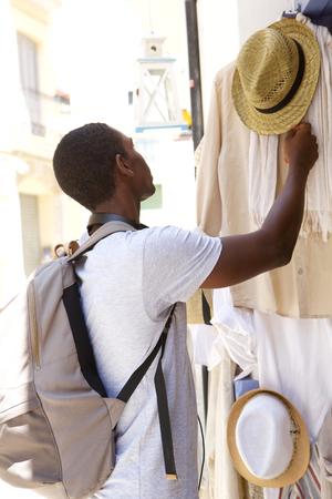 black guy: Portrait of a young black guy shopping outside Foto de archivo