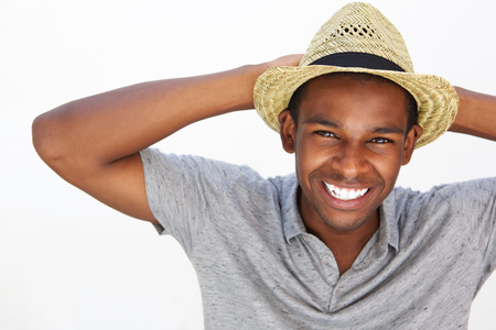 white  hat: Close up portrait of a cheerful man laughing with hands behind head